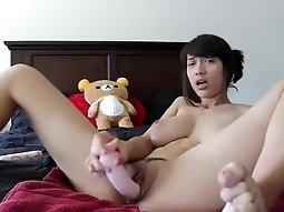 Hot asian girl plays with dildo