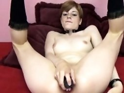 Redhead coed Ava Little is stuffing a dildo in her hot ass